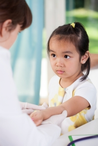 View of scared asian girl before vaccine