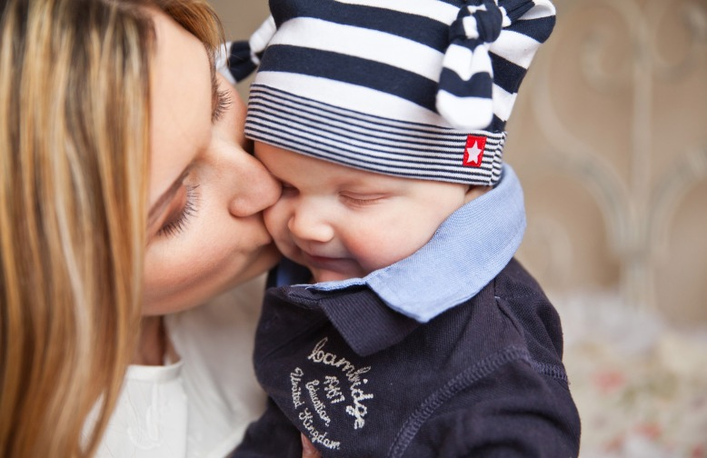 kissing baby goodbye