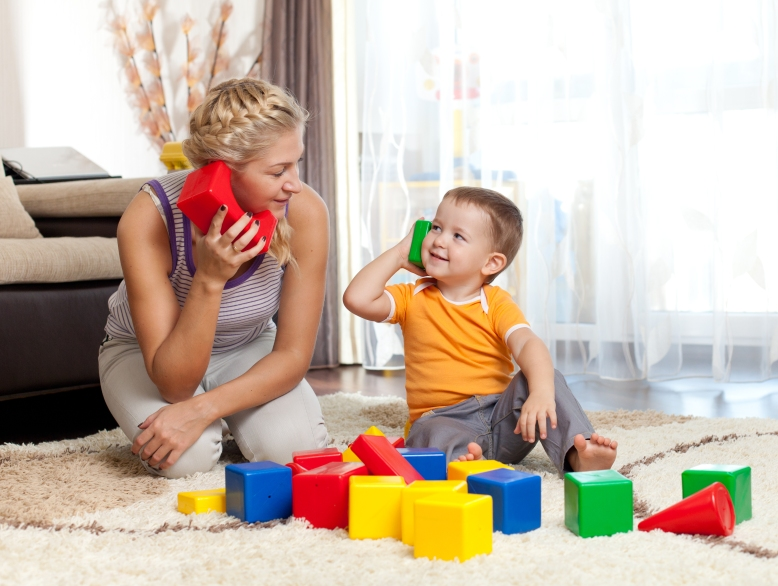 Mom and boy playing blocks
